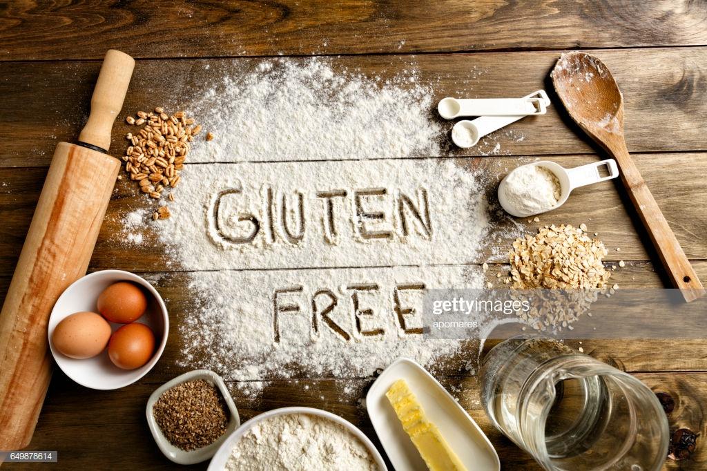 gluten-free-bread-ingredients-and-utensils-on-wood-frame-bac.jpg